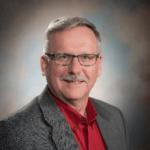 Curtis Brown gray jacket red shirt