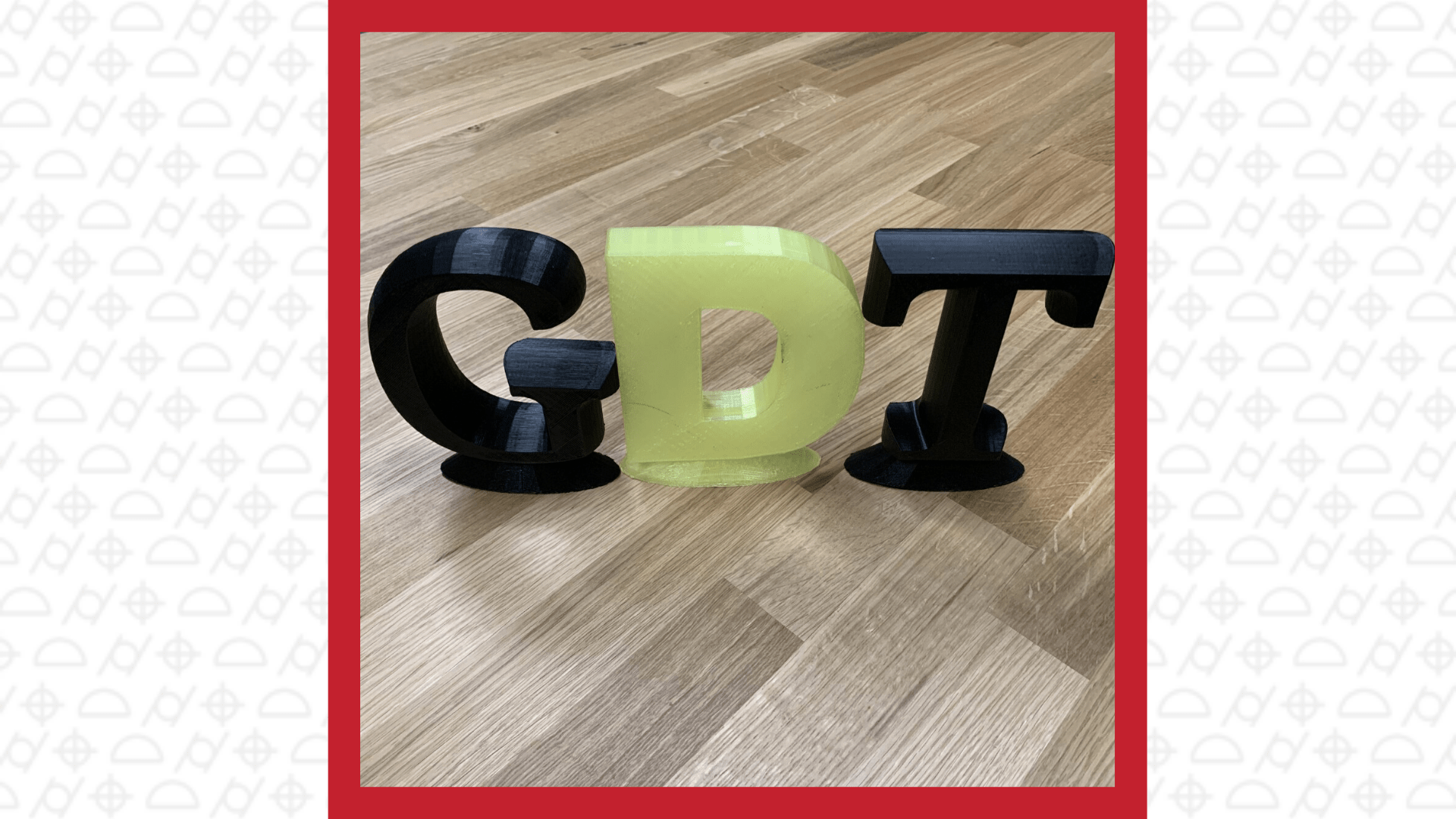 3D printed capital letters, black G, black T, yellow D