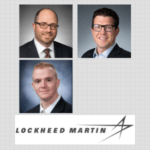 Lockheed Martin Logo and 3 engineerings in charcoal gray jackets with white shirts