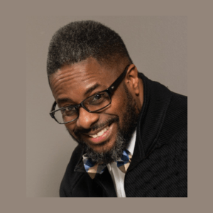 Myon Caruthers profile image wearing glasses, black jacket, bow tie